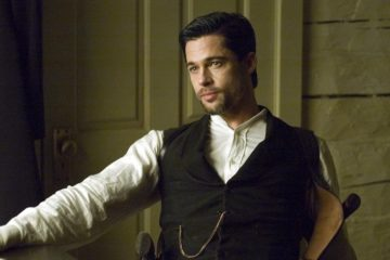 Brad Pitt sitting in field in The Assassination of Jesse James by the Coward Robert Ford (2007)