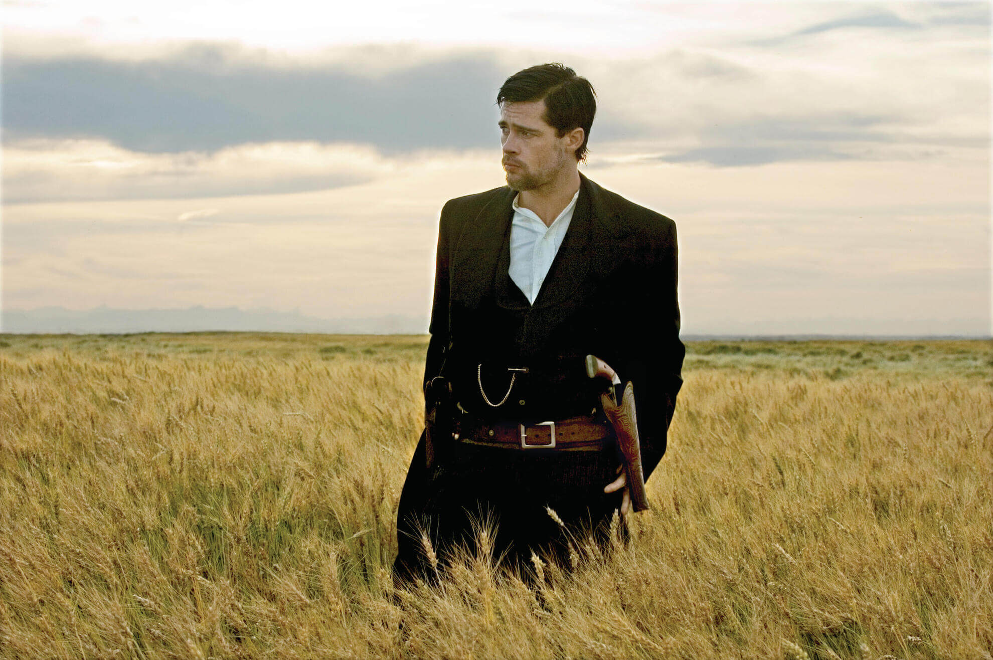 Brad Pitt standing in field in The Assassination of Jesse James by the Coward Robert Ford (2007)