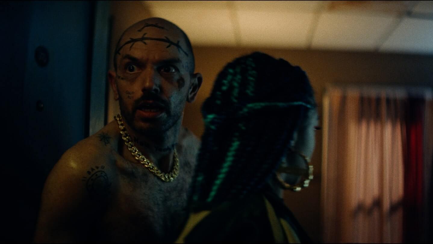 Paul Scheer as Krieg and Zolee Griggs as Indigo in Archenemy (2020)