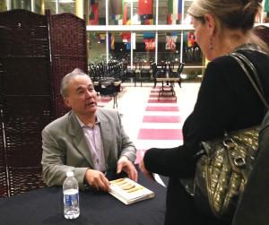 Dr. Davis signs books at his recent talk in Halifax