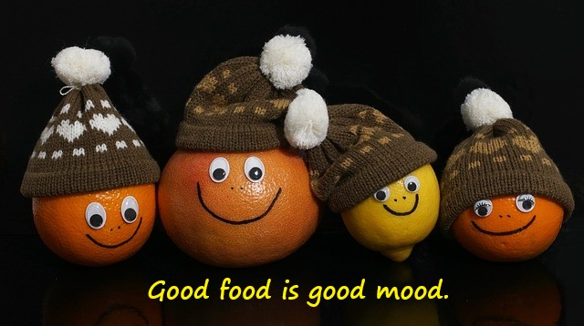 Good Food is Good mood quote for mental health on pic with oranges wearing hats