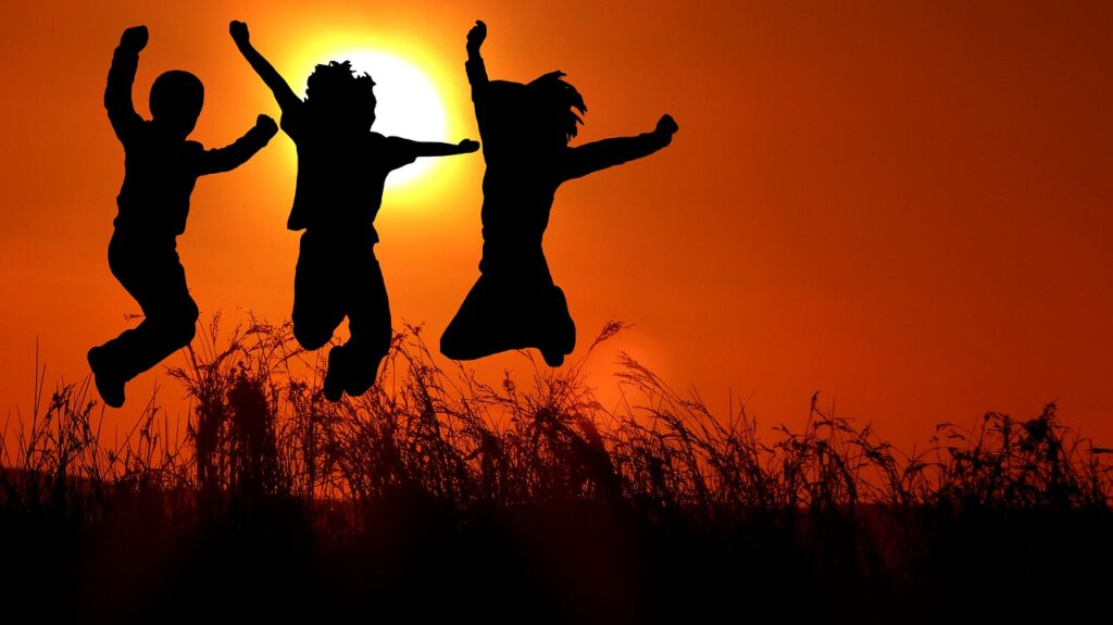 people jumping showing happiness