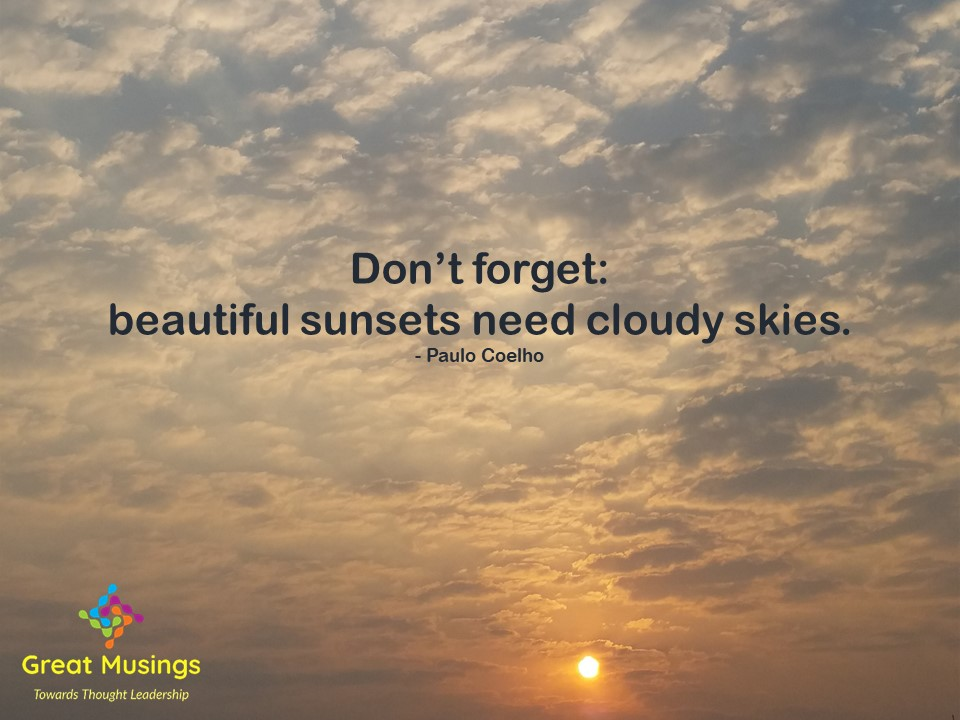 Paulo Coelho Clouds Quotes in a cloudy pic with sun