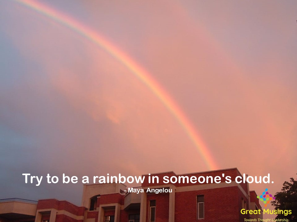Maya Angelou Clouds Quotes in a colorful pic with rainbow