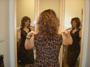 Woman in leopard dress in changeroom