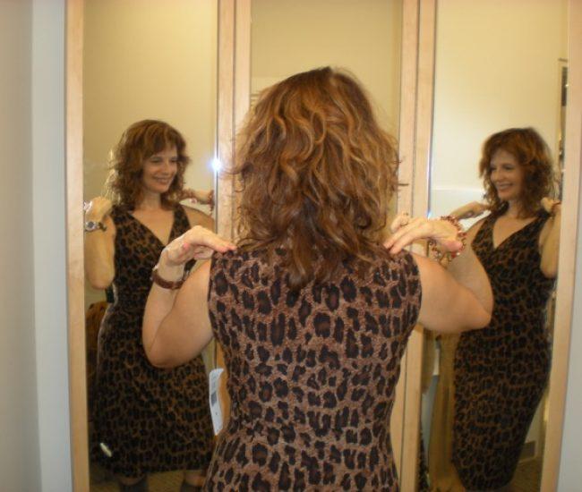 changeroom trying on leopard dress