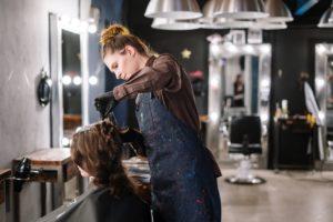 woman getting hair colour