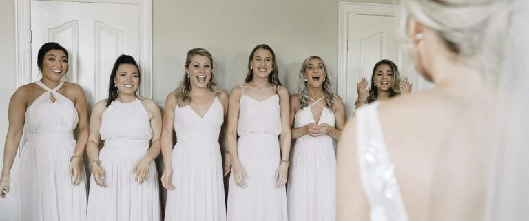 first look with bridesmaids at wedding