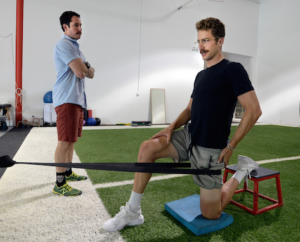 Taylor Phinney, right, works with physical therapist, Matt Smith, of Revo Physiotherapy in Boulder. Cliff Grassmick Staff Photographer