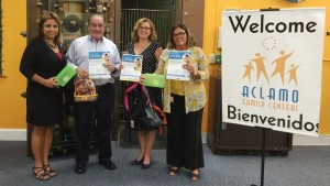 Executive Director Nelly Jimenez-Arevalo thanks Pfizer donors Miguel Cacho, Jessica Presa and Arlete Fancio.