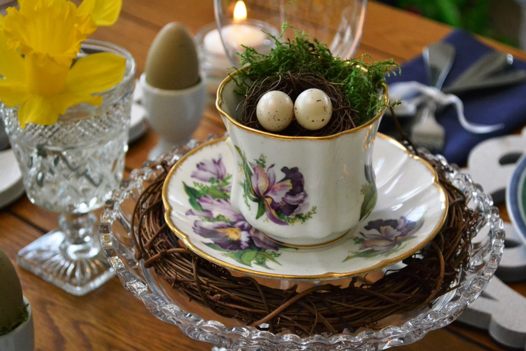 """Nothing says """"spring"""" like a nest filled with eggs. From Our Easter Table Setting at thehousedownthelane.com"""
