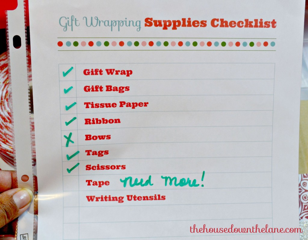 Is holiday gift wrapping a drag? Make it easier and more enjoyable by creating a DIY Mobile Gift Wrapping Station! And never run out of tape again!! | TheHouseDowntheLane.com
