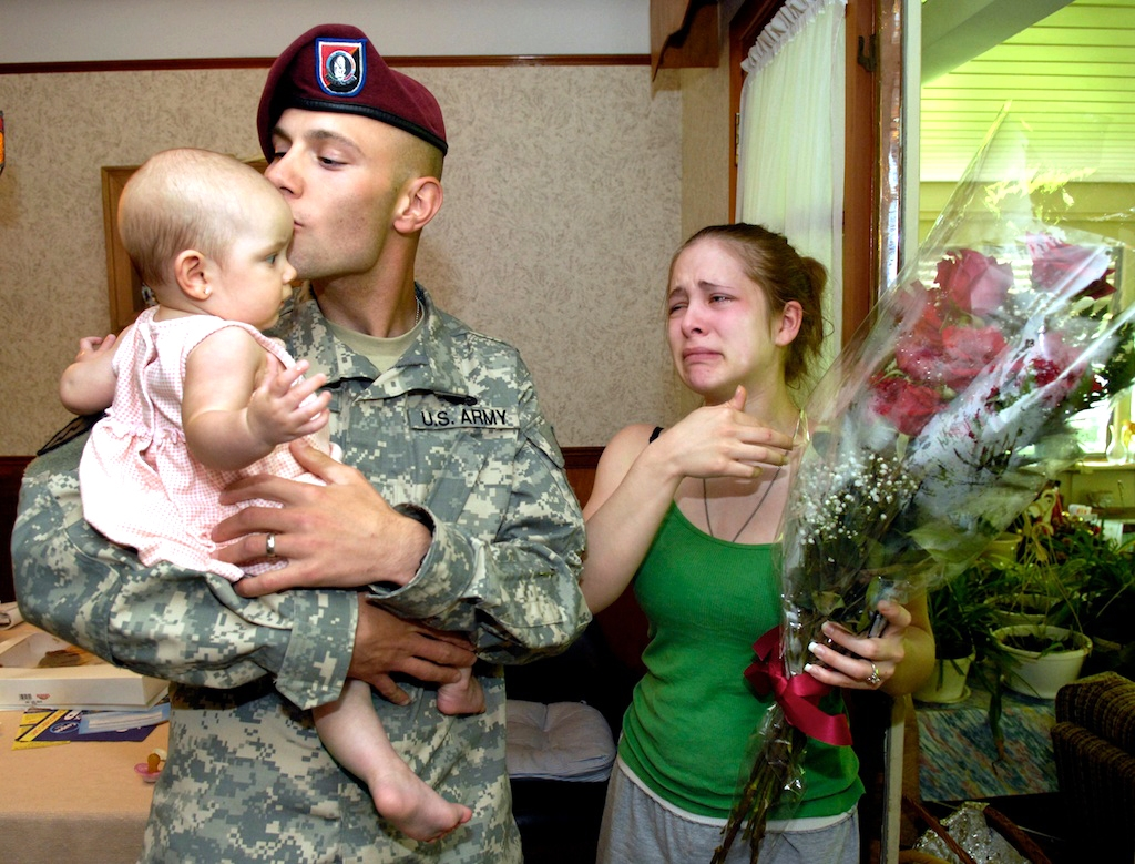 Army Specialist Troy Fishcer meets his six-month-old daughter for the first time
