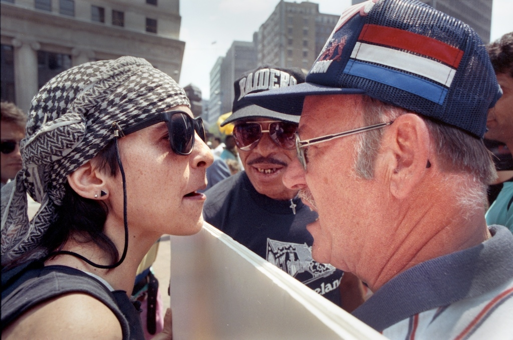 An anti-war demonstrator confronts a supporter during a rally