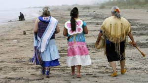 Charlotte Showne Olivia Cloud, and Catheryn Mandocka, left to right, who participated in ceremonies walk on Ipperwash beach after the signing the transfer agreement for Ipperwash Provincial Park to be transferred to the Chippewas of Kettle and Stony Point First Nation, on May 28, 2009, at Ipperwash, near Forest, Ont. (DAVE CHIDLEY/The Canadian Press)
