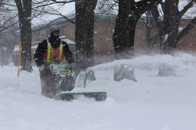 Crews worked to clear the heavy snowfall