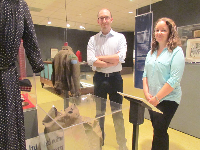 Laurie Webb, right, curator-supervisor of the Lambton County Museums, and assistant curator Luke Stempien are shown on Wednesday June 10, 2015 in Lambton Shores, Ont., at the Lambton Heritage Museum's new exhibit, Lambton at War. Paul Morden/Sarnia Observer/Postmedia Network