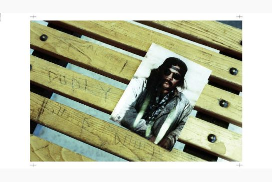 GLENN OGILVIE / THE CANADIAN PRESS A photograph of Dudley George is affixed to a bench inside the provincial court building in Sarnia, Ont. Thursday. Beside it is a signature carved by the Stoney Point native, who died in an 1995 confrontation with Ontario Provincial Police.