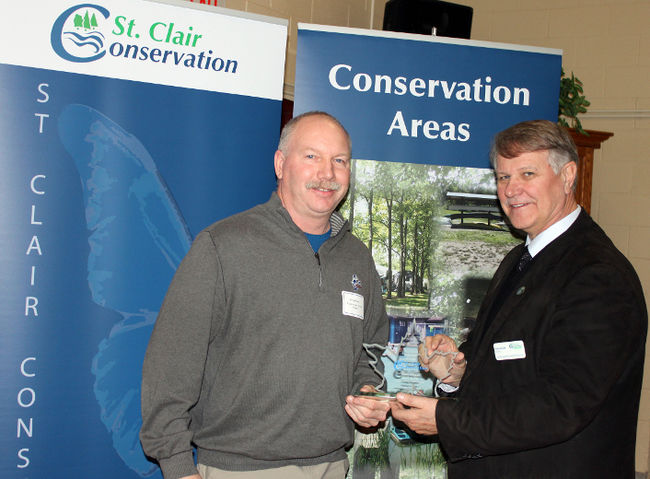 Doug Rogers (left) of Lambton Shores was formally recognized by the St. Clair Region Conservation Authority for his land stewardship work. He's shown with St. Clair Township Mayor Steve Arnold, who was returned as chair of the conservation authority at Thursday's annual general meeting in Strathroy. Also formally recognized for their conservation efforts were John and Mary-Ellen King of Warwick Township. (HANDOUT/ SARNIA OBSERVER/ POSTMEDIA NETWORK)