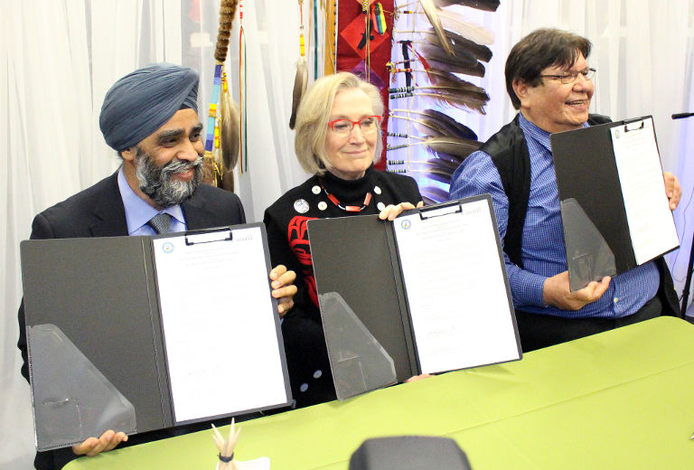 Minister of National Defence Harjit Sajjan, Minister of Indigenous and Northern Affairs Dr. Carolyn Bennett and Kettle and Stony Point Chief Tom Bressette