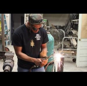 Brain Green welding in the shop.