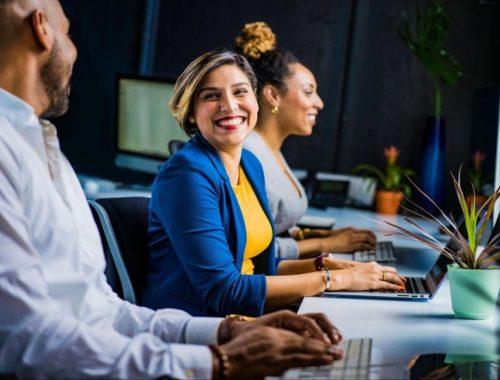 three people working at an organization
