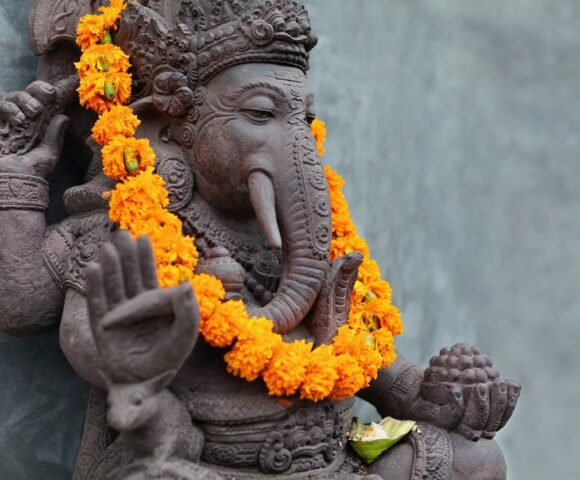 Ganesh statue with garland of marigolds