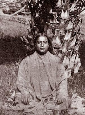 Paramhansa Yogananda meditating outside