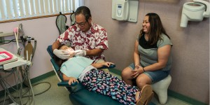 Dr. Dean Sueda consulting with mother and new patient