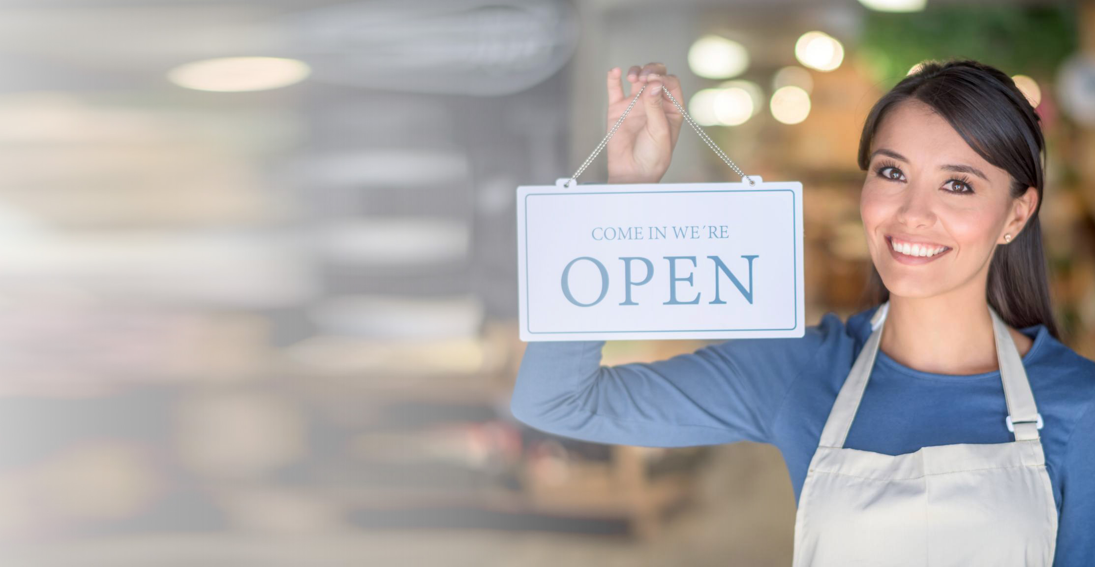 Women Entrepreneur in Small Business with Open sign