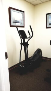 An elliptical trainer or cross-trainer (also called an X-trainer) is a stationary exercise machine used to simulate stair climbing, walking, or running without causing excessive pressure to the joints, hence decreasing the risk of impact injuries. For this reason, people with some injuries can use an elliptical to stay fit, as the low impact affects them little. Elliptical trainers offer a non-impact cardiovascular workout that can vary from light to high intensity based on the speed of the exercise and the resistance preference set by the user.