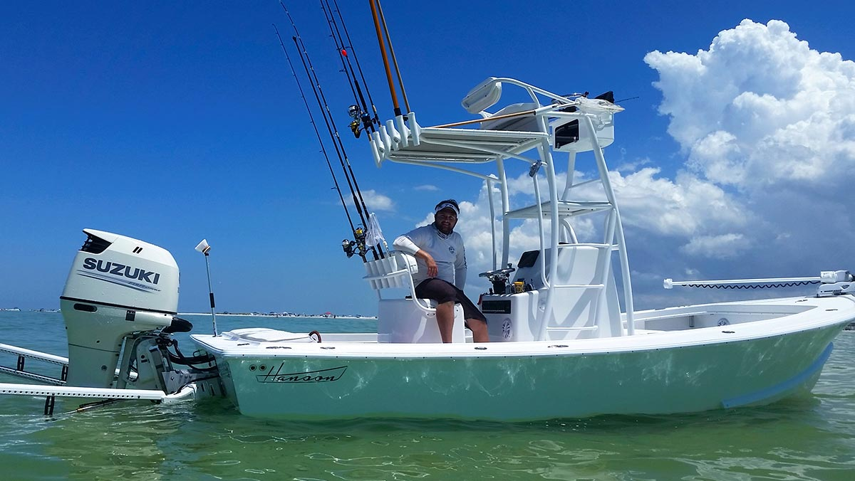 Captain Matt Luttmann with his Hanson charter boat anchored in the shallows with Powerpoles.