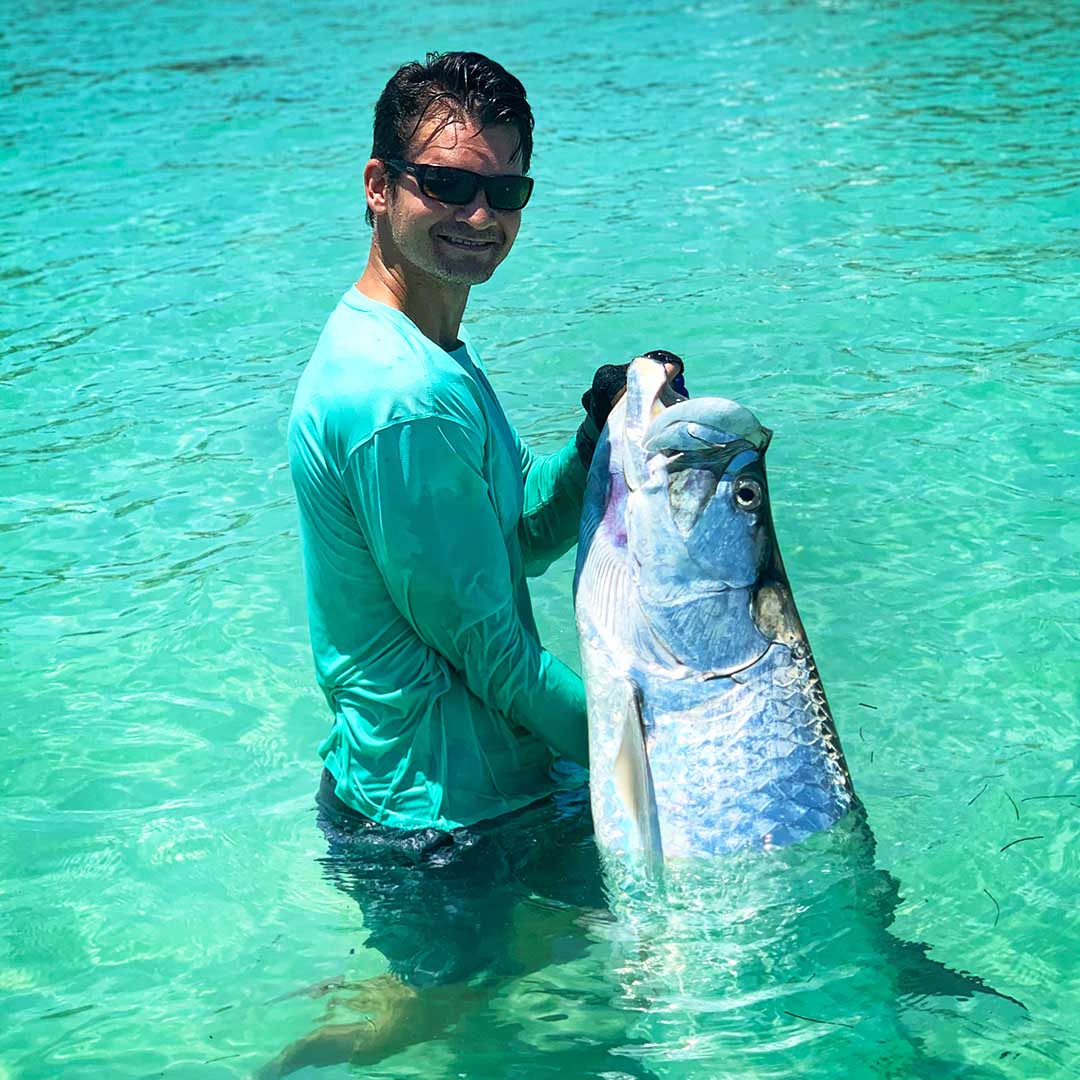 Had to jump in the water with this tarpon after an exciting fight.