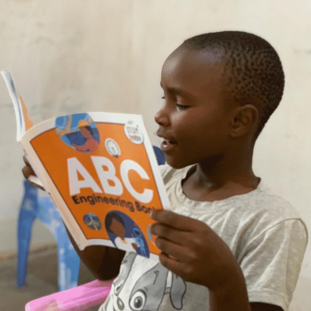 Litter girl reading ABC