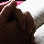 praying w bible_red