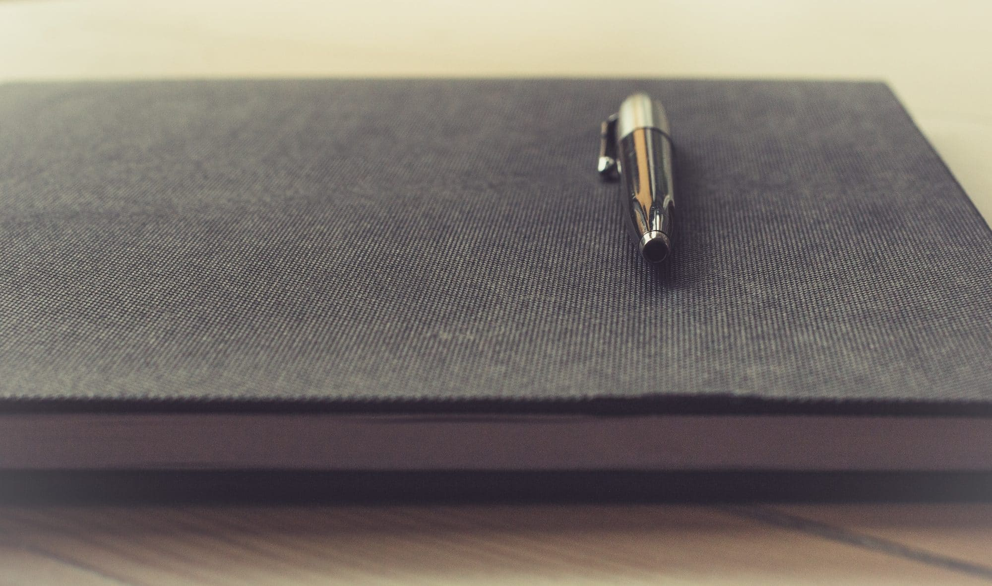 pen on top of document book