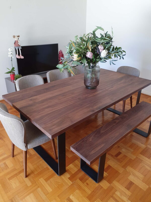 Walnut Dining table with steel & trapezoid legs