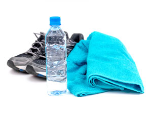 A bottle of water, joggers and a sports towel
