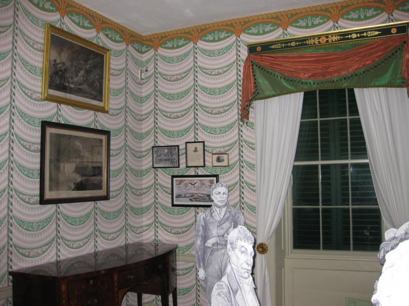 The enslaved Paul Jennings stands behind the Marquis de Lafayette in Montpelier's dining room.