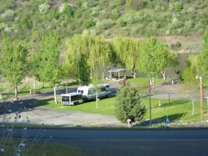 View of Swiftwater RV Park from above on the side of the mountain across the road.