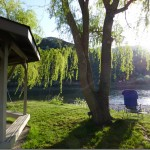 Gazebo and lawn and willow tree at Swiftwater Rv Park in Idaho