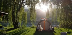 A guest pitched this tent on the lawn, facing the Salmon River, at Swiftwater RV Park near White Bird, Idaho Park