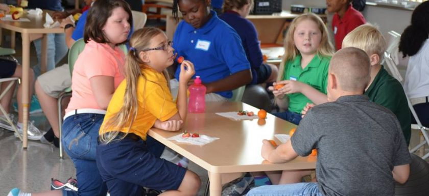 Middle School students talk together during snack at Cypress Junction Montessori.