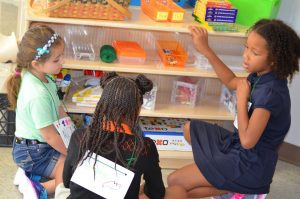 Three students work together at Cypress Junction Montessori. CJM is currently accepting applications for enrollment.