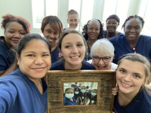 Virginia Health Services apprentices gave instructor Nora Gillespie a framed photo they signed as a graduation gift