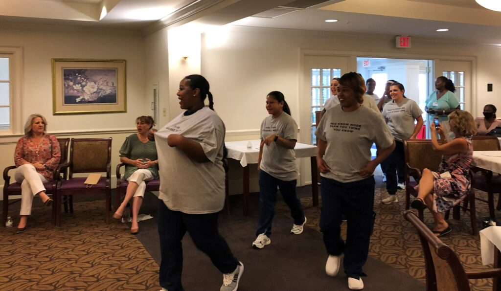 Virginia Health Services apprentices surprise instructor Nora Gillespie with T-shirts