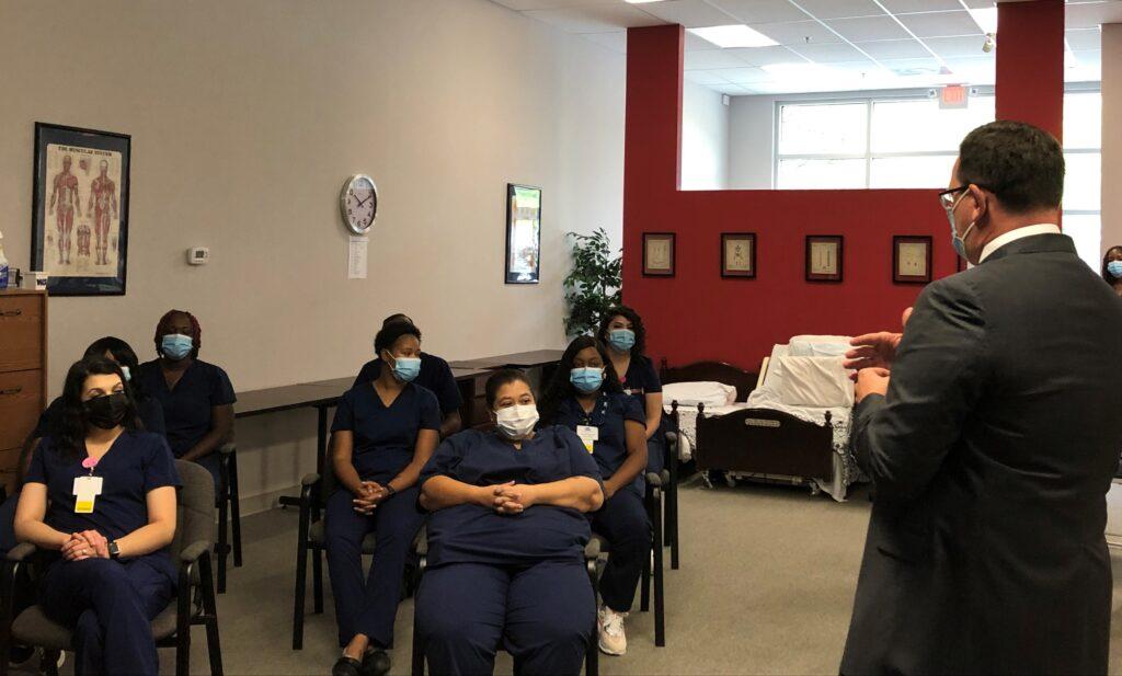 Virginia Health Services CEO Mark Klyczek addresses graduates.