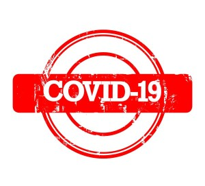 COVID-19 stamp in red isolated on a white background.