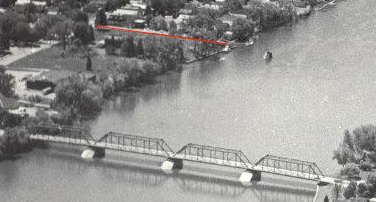 Detail of old photo; Waterford Bridge in foreground, 123rd Street annotated in red.