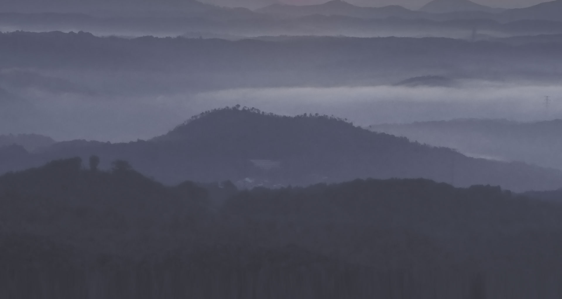 our mission photo; dark photo of rolling hills for sports medicine experts homepage